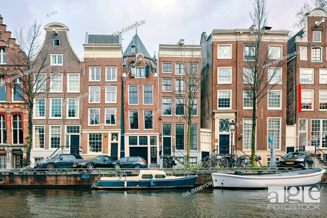 Photo de stock: Multistorey office and residential buildings along canal, Amsterdam, Noord-Holland, Netherlands.