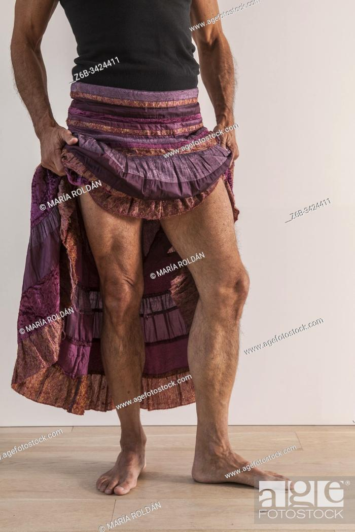 Stock Photo: man wearing a womans skirt.