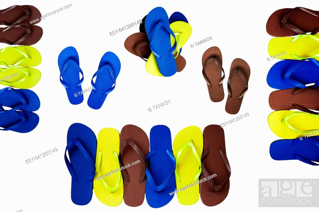 952ca75cd27f Stock Photo - Several pairs of multi-colored rubber flip-flops exhibited in  a row