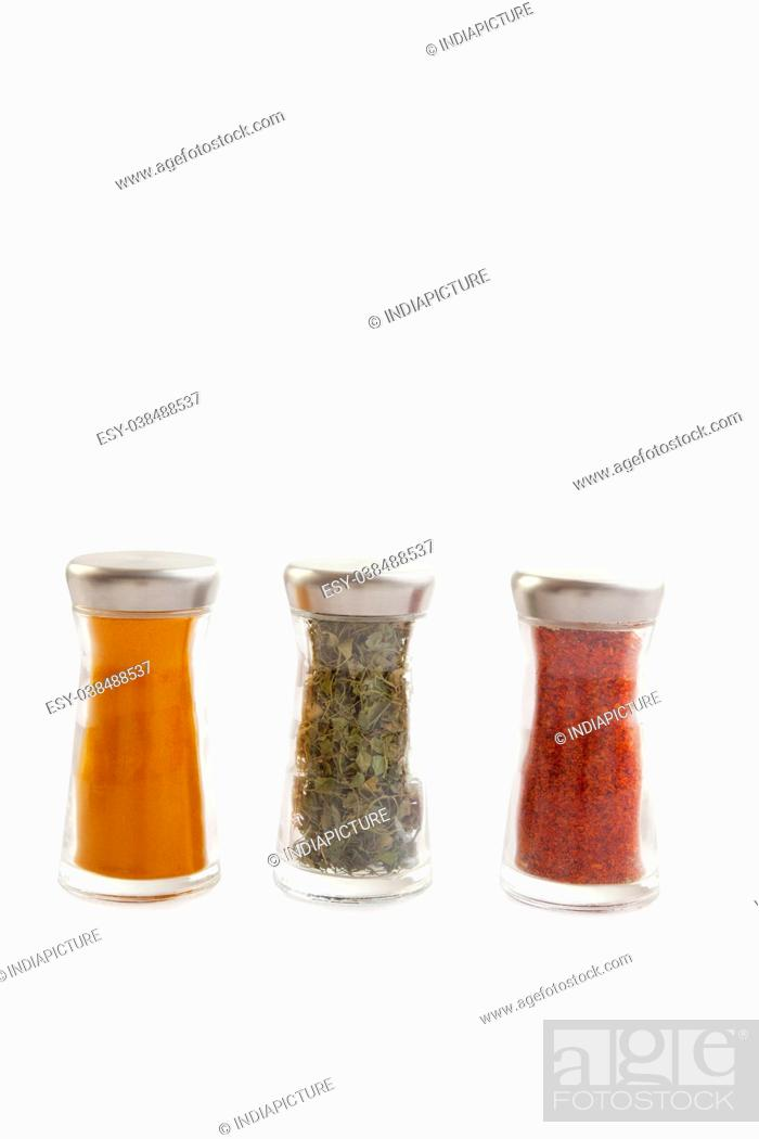 Stock Photo: Spices in glass bottles.