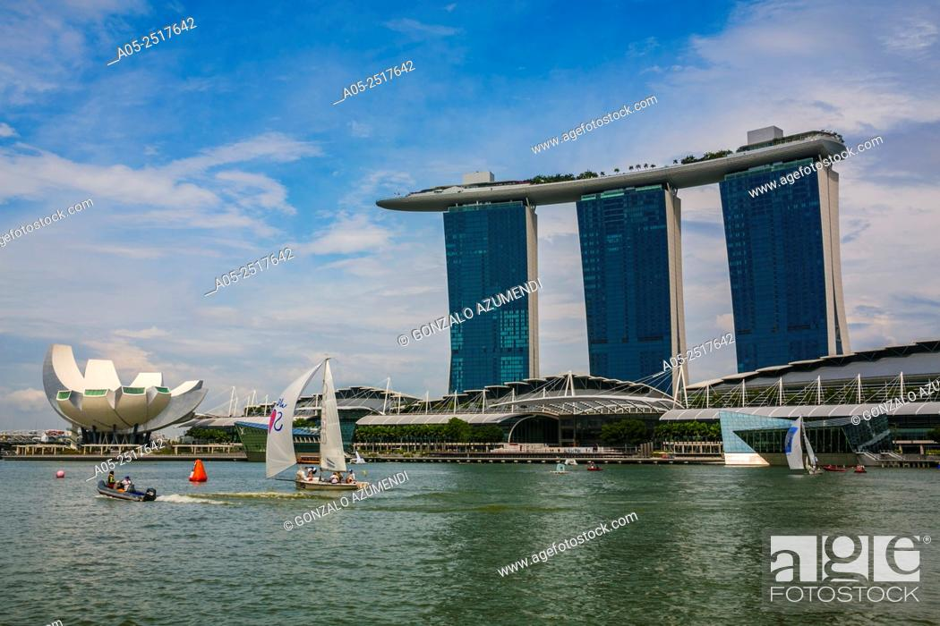 Stock Photo: In the background Marina Bay Sands Hotel. On the left ArtScience Museum . Marina Bay. Singapore. Asia.