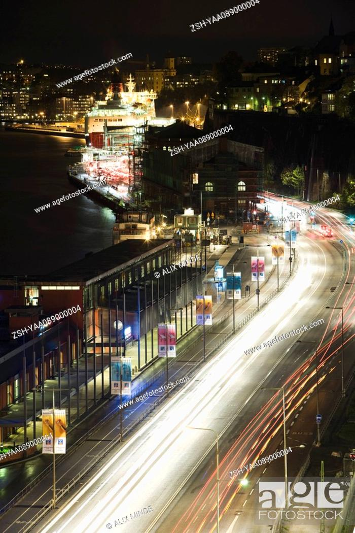 Stock Photo: Sweden, Sodermanland, Stockholm, street illuminated by light trails at night.