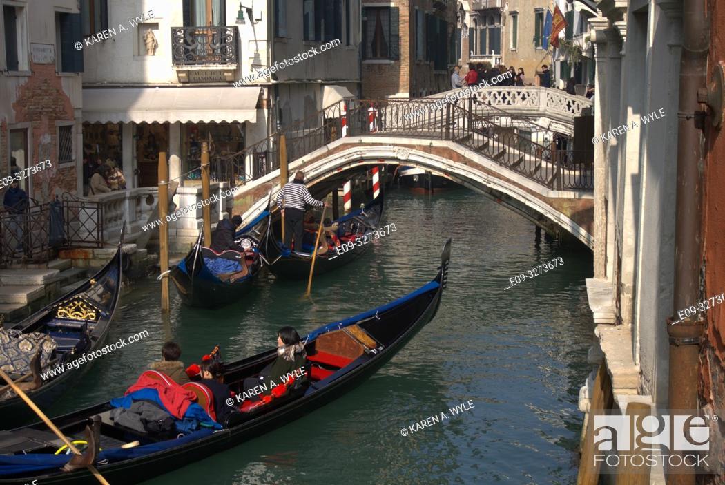 Stock Photo: canal with three gondolas and two bridges, Venice, Italy.