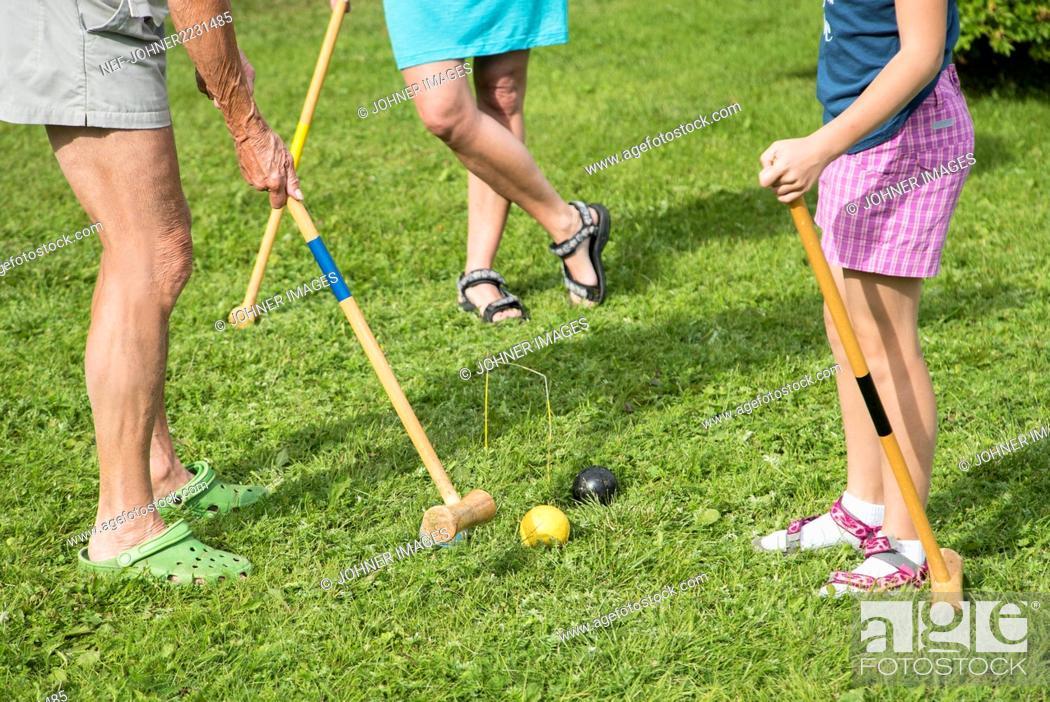 Imagen: Playing croquet.