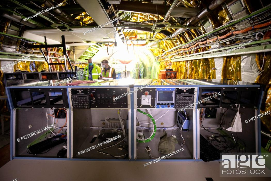 Stock Photo: 26 October 2020, Hamburg: Technicians work in the cabin for the research systems in a converted Boeing 747 with the Stratospheric Observatory for Infrared.