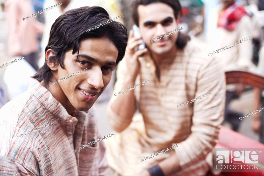 Stock Photo: Portrait of two young men sitting in a rickshaw.