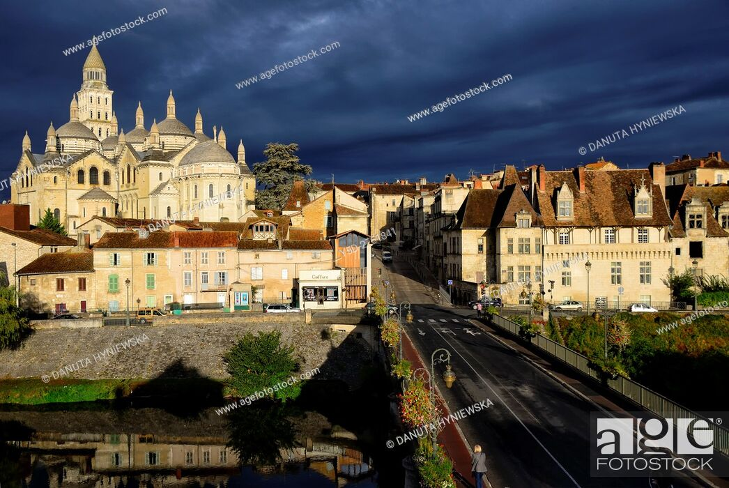 Stock Photo: Panoramic view of Old Town of Périgueux with dark sky, in front Saint-Front Cathedral and bridge Pont des Barris over Isle river, Périgueux.
