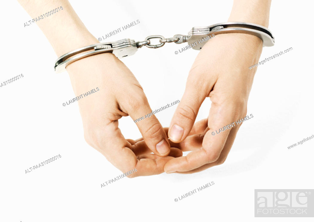 Stock Photo: Handcuffed woman, close-up of hands.