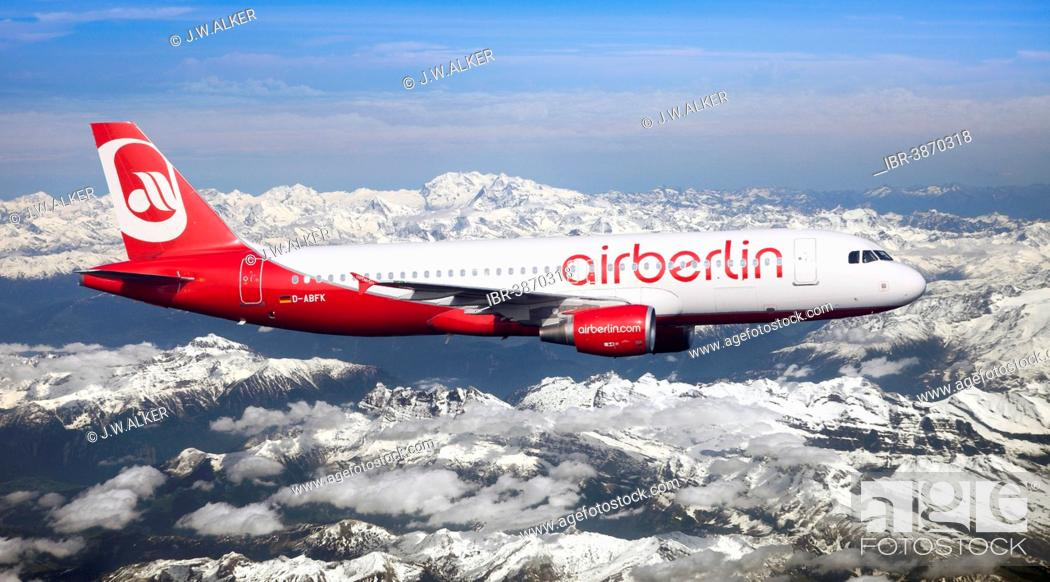 Stock Photo: Air Berlin Airbus A320-214 in flight over the Alps, Switzerland.