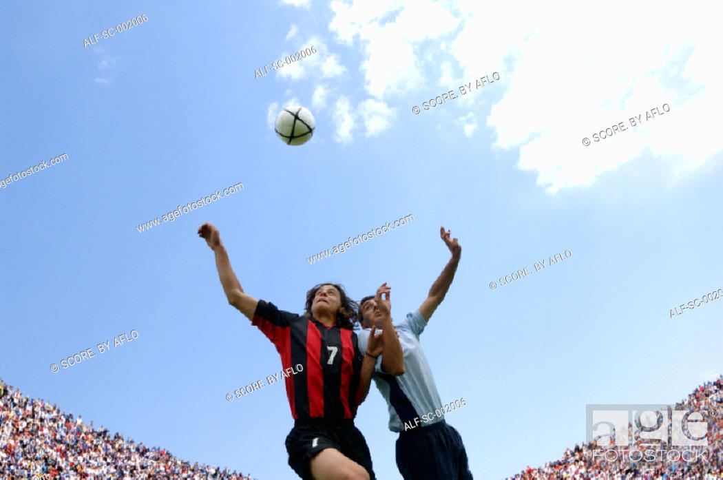 Stock Photo: Soccer players jumping for the ball.