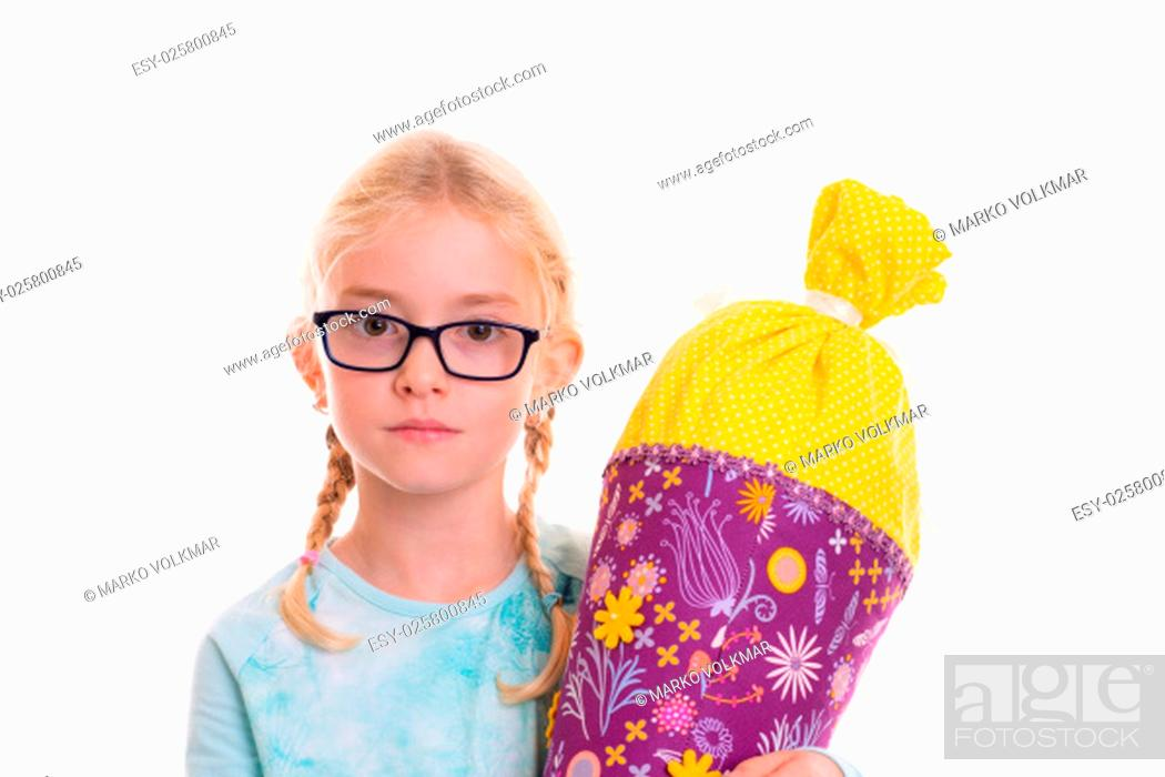 Stock Photo: blond girl on first day at school.