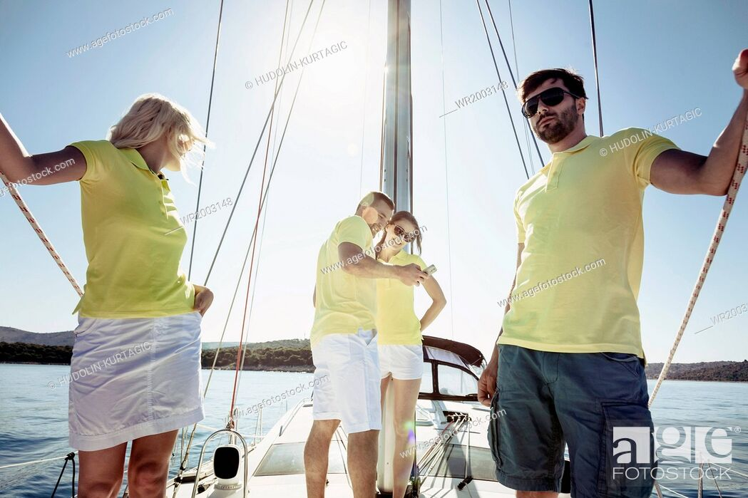 Stock Photo: Group of friends together on sailboat, Adriatic Sea.