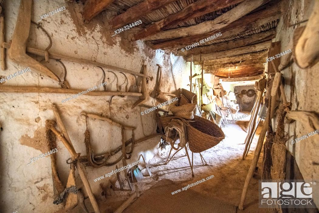 Stock Photo: View down hallway of Muse de la Memoire Nomade with a variety of traditional farming equipment on display from the Berber nomads, Tighmert Oasis, Morocco.