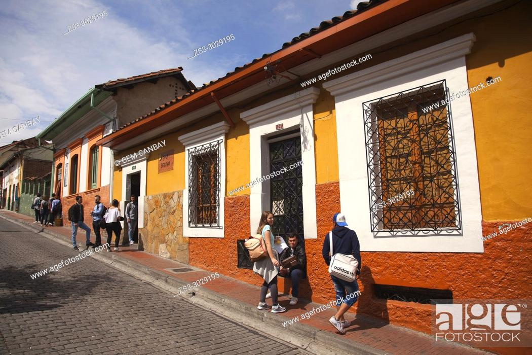 Stock Photo: Students in front of the colonial buildings near the University-Universidad De La Salle at the historic center, Bogota, Cundinamarca, Colombia, South America.
