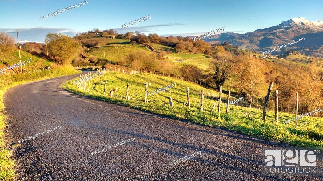Stock Photo: Road (BI-1) between Binenes and Siero, and Sierra de Peñamayor in background. Asturias, Spain.