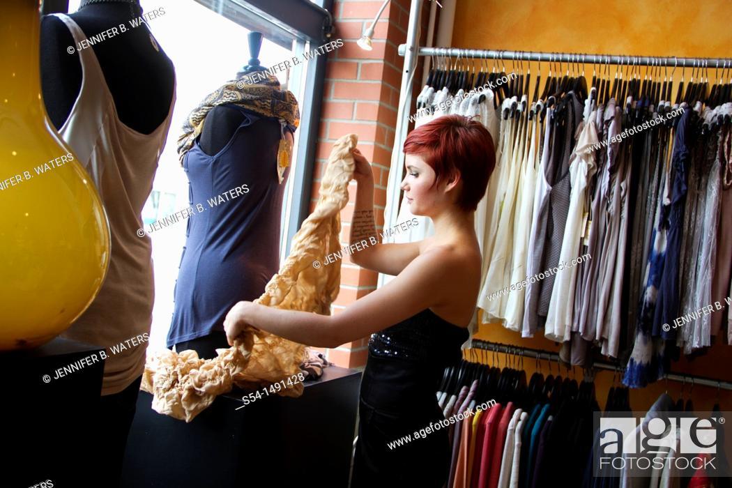 Stock Photo: A young woman shopping in Spokane, Washington, USA.
