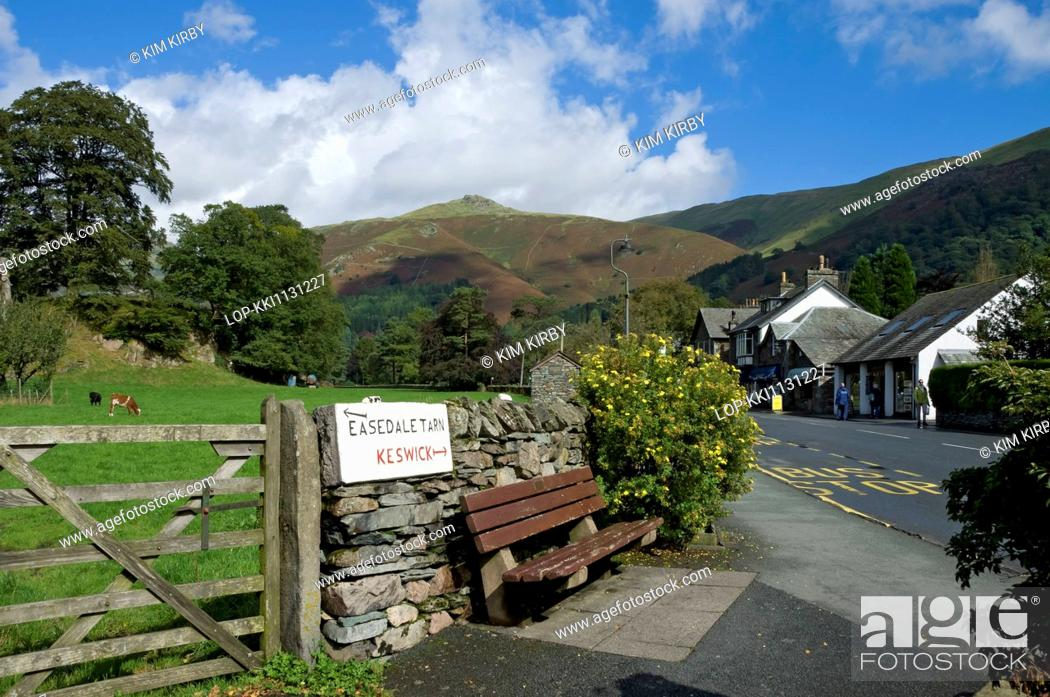 Stock Photo: England, Cumbria, Grasmere. Sign on wall showing direction of Keswick and Easedale Tarn.