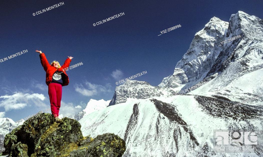 Stock Photo: Trekker relishes the beauty of the Khumbu Himal, North Ridge Ama Dablam behind, Sagarmatha National Park, Nepal Himalaya.