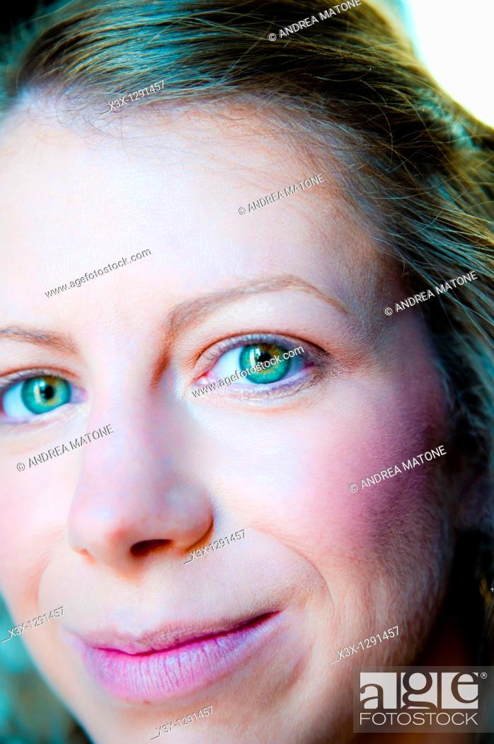 Stock Photo: Close-up of young woman's face.