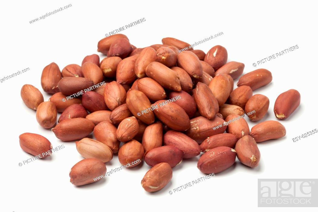 Photo de stock: Heap of peeled peanuts on white background.