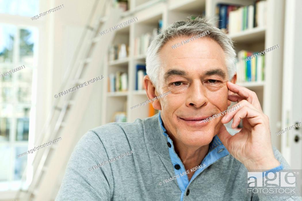 Stock Photo: Germany, Berlin, Senior man smiling, portrait.
