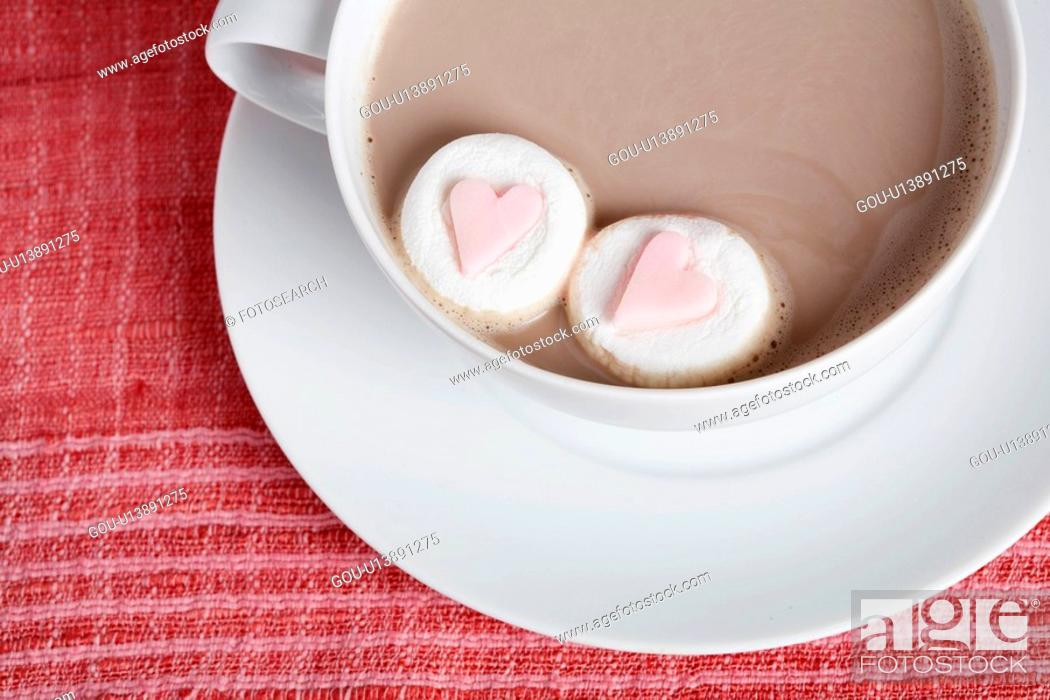 Stock Photo: Heart shaped candies in cappuccino (close-up, directly above).