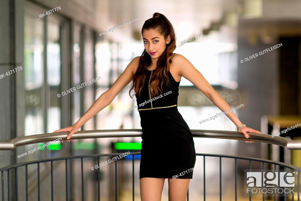 Stock Photo: Portrait of a woman in a black evening dress.