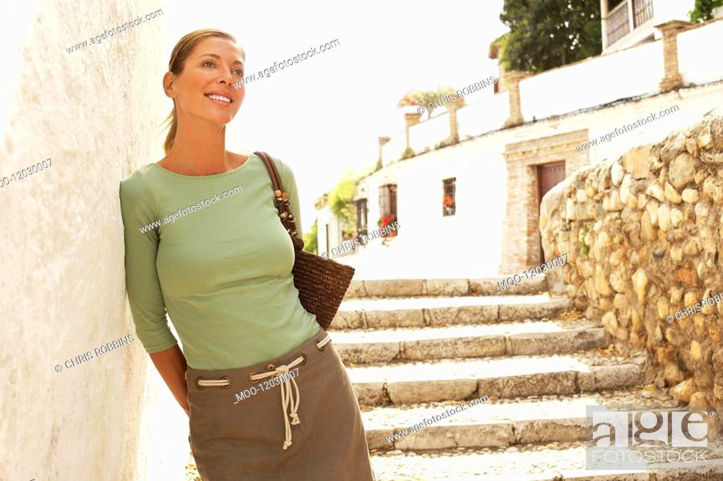 Stock Photo: Tourist on Steps in Granada Spain front view.