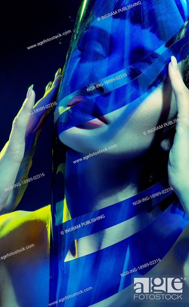 Stock Photo: Brunette lady trying to put on the plastic mask.