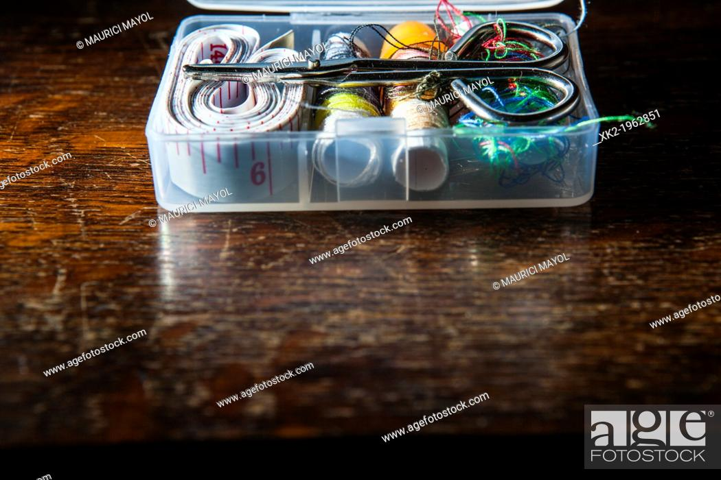 Stock Photo: sewing box kit on rustic wood.