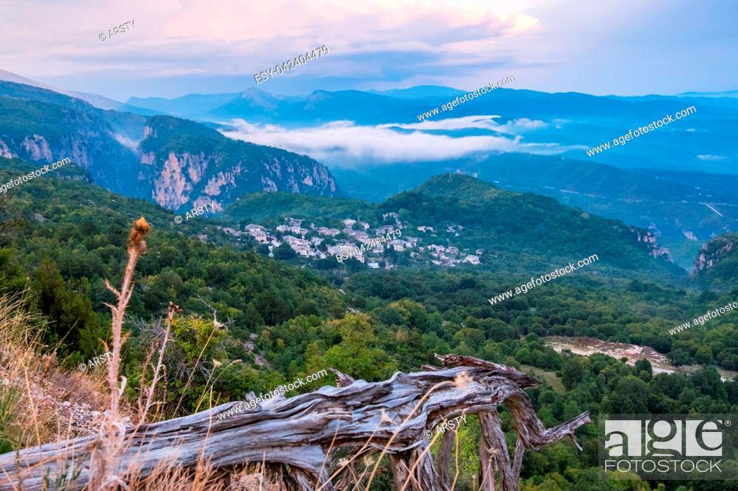 Imagen: View of Pindus mountain range after sunset. Monodendri on a distance. Zagoria, Epirus, Greece.