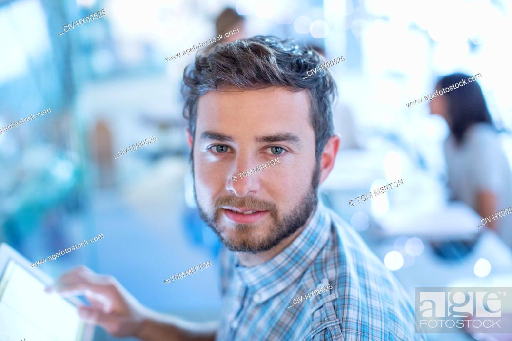 Stock Photo: Portrait confident businessman with digital tablet.
