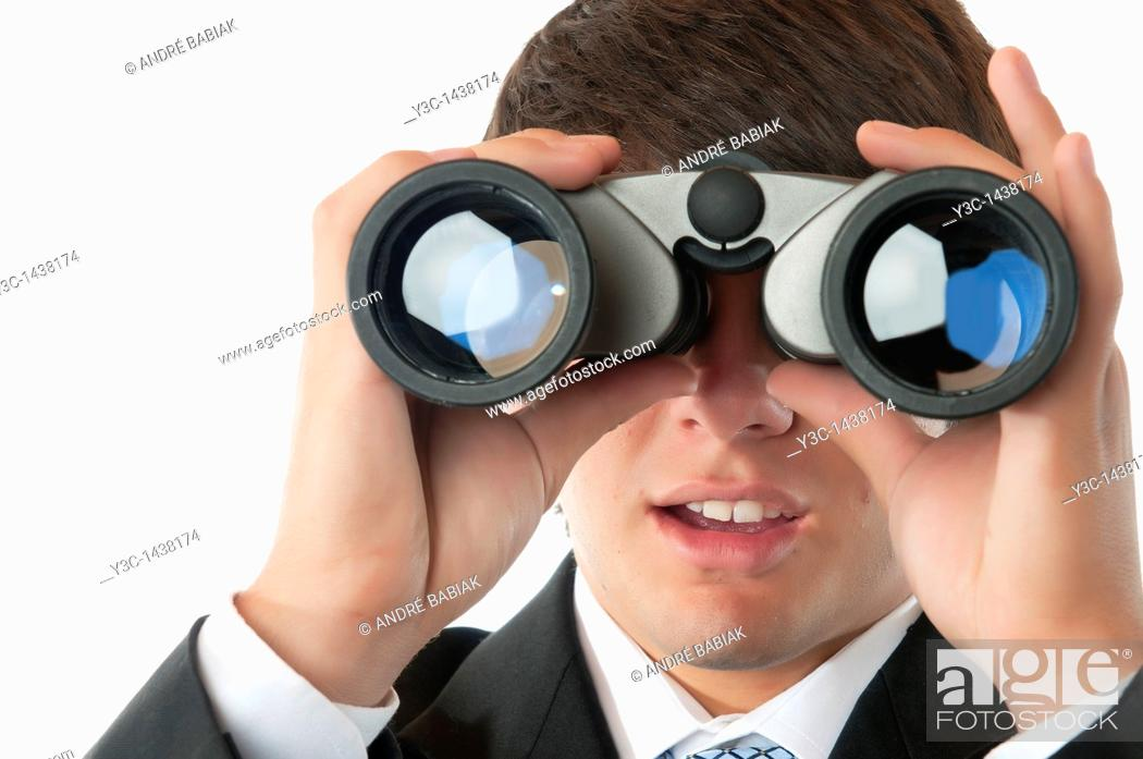 Stock Photo: Young business man with binoculars.