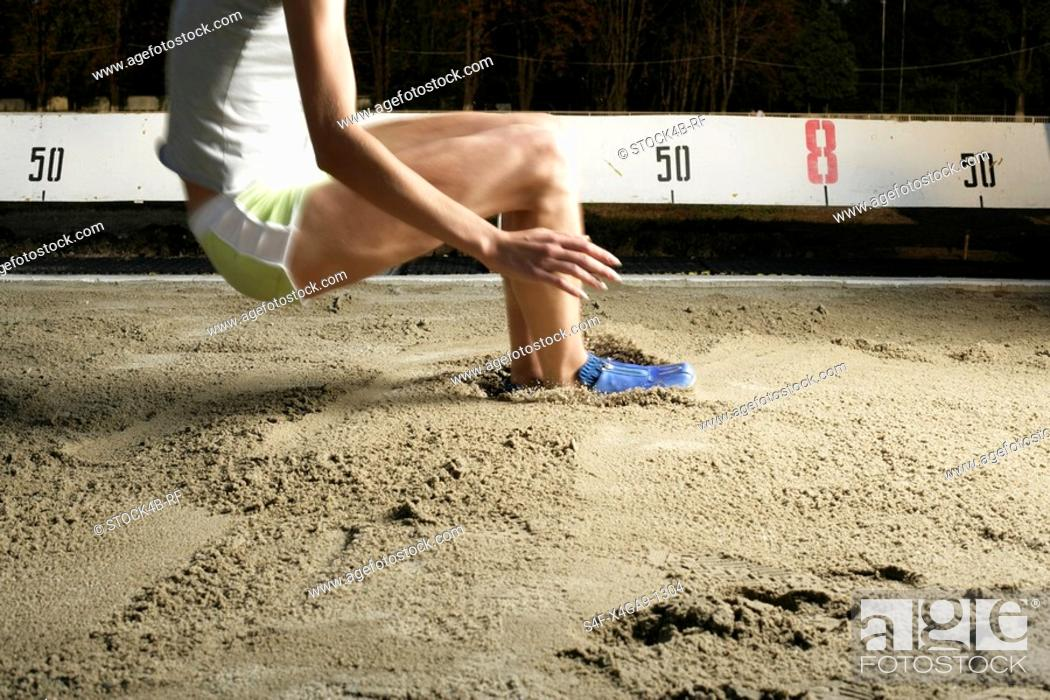 Stock Photo: Woman making long jump.
