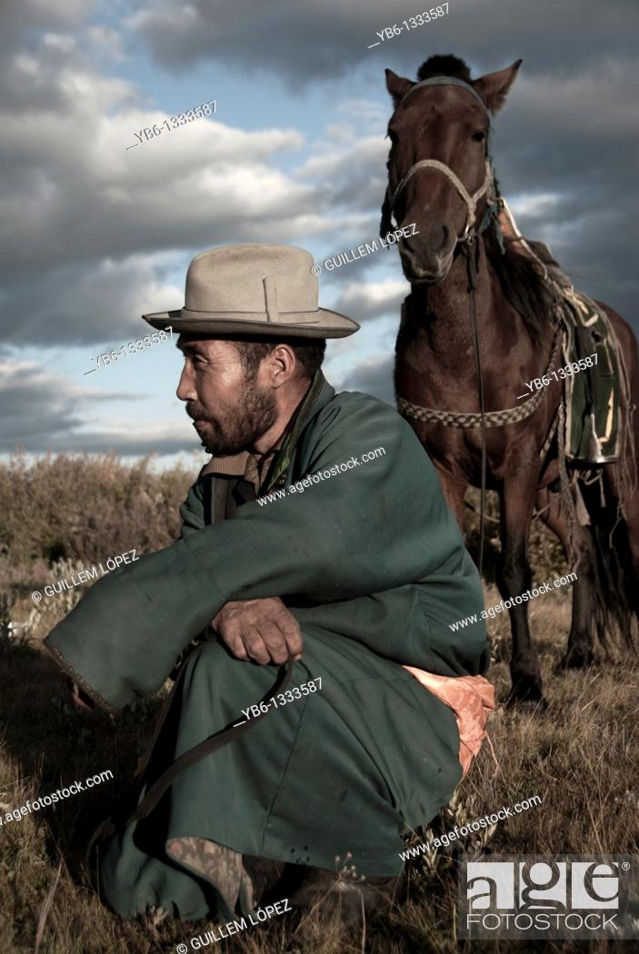 Stock Photo: Nomad with his horse in Northern Mongolia.