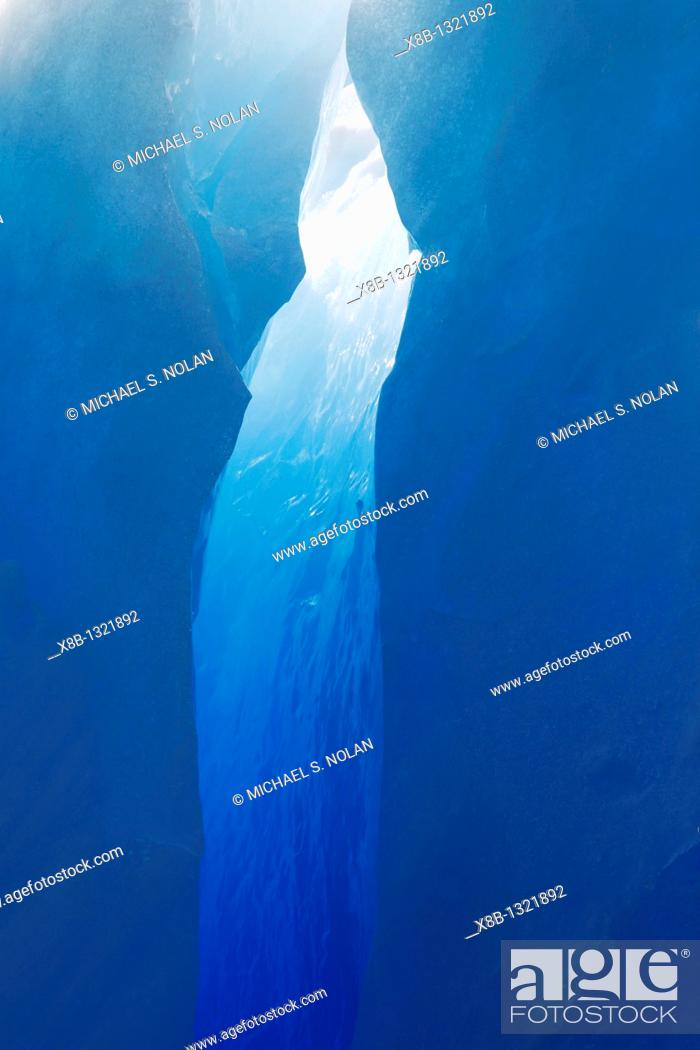 Stock Photo: Close-up view of a crevasse in a huge Iceberg calved from the LeConte Glacier just outside Petersburg, Southeast Alaska, USA  Pacific Ocean.