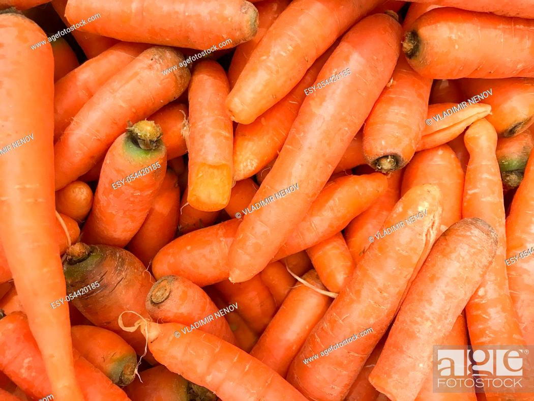 Stock Photo: Image Of Organic Carrots At Market. Healthy fresh food background.
