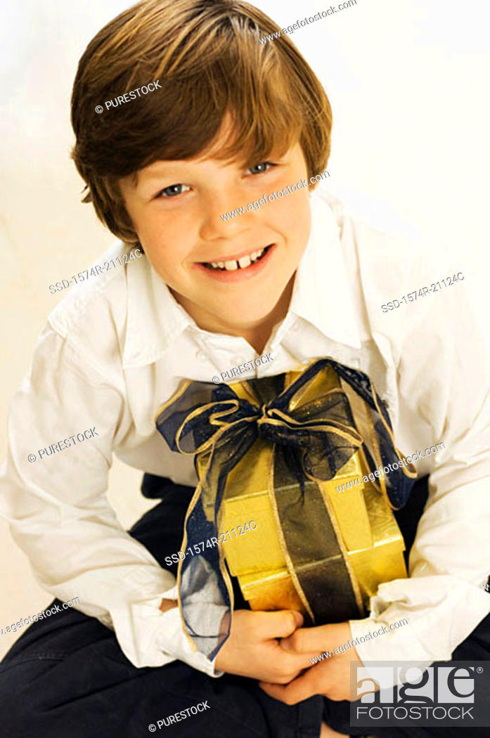 Stock Photo: Portrait of a boy with a Christmas present.