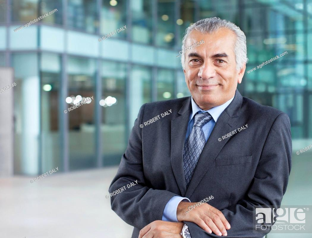 Stock Photo: Portrait confident, smiling senior businessman.