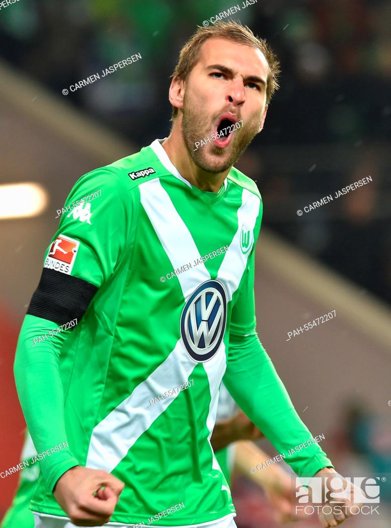 sports shoes 541a8 8cf71 Wolfsburg's Bas Dost cheers after scoring a goal during the ...
