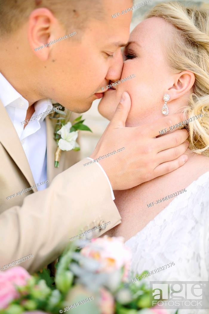 Stock Photo: Bride and groom kissing.