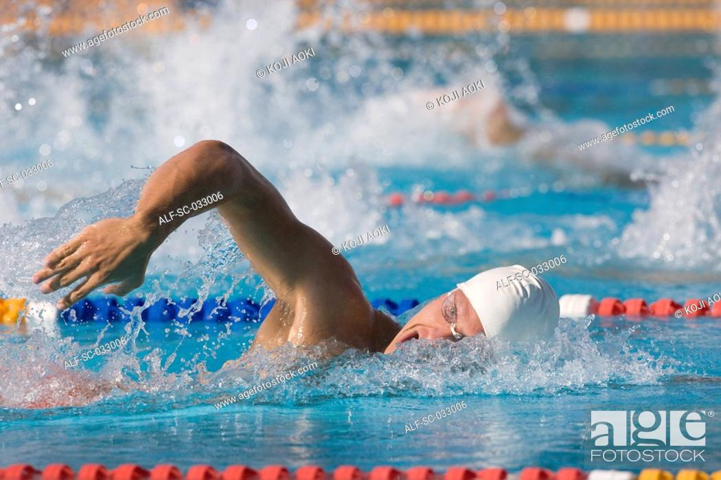 Stock Photo: Young swimmer doing front crawl.