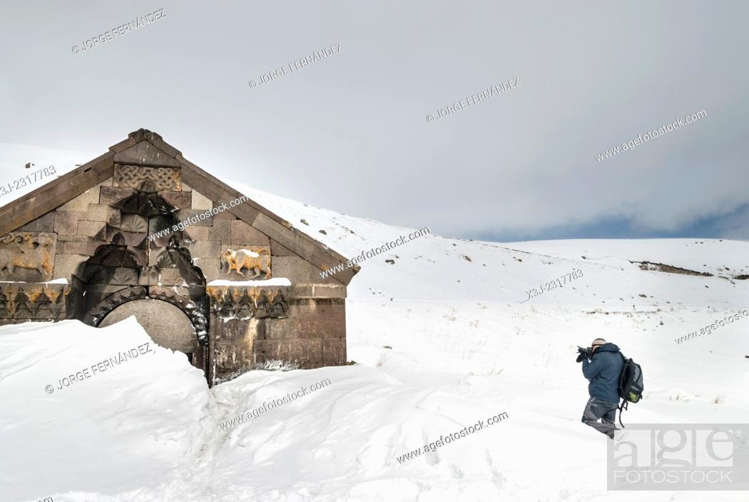Stock Photo: Man photographing the ruins of a church, Armenia.