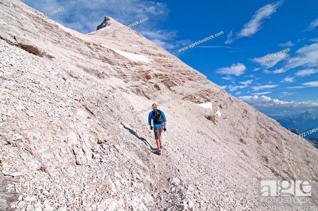 Stock Photo: Man climbing the Giovanni Lipella via ferrata on Tofana De Rozes in the Dolomite Mountains near the city of Cortina in northern Italy.