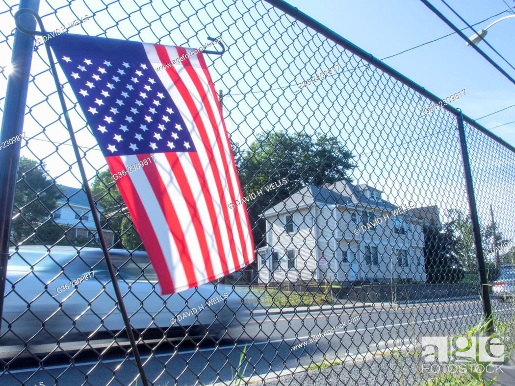 Stock Photo: American flag on chainlink fence at the Manton Bend Community Garden in Providence, Rhode Island.