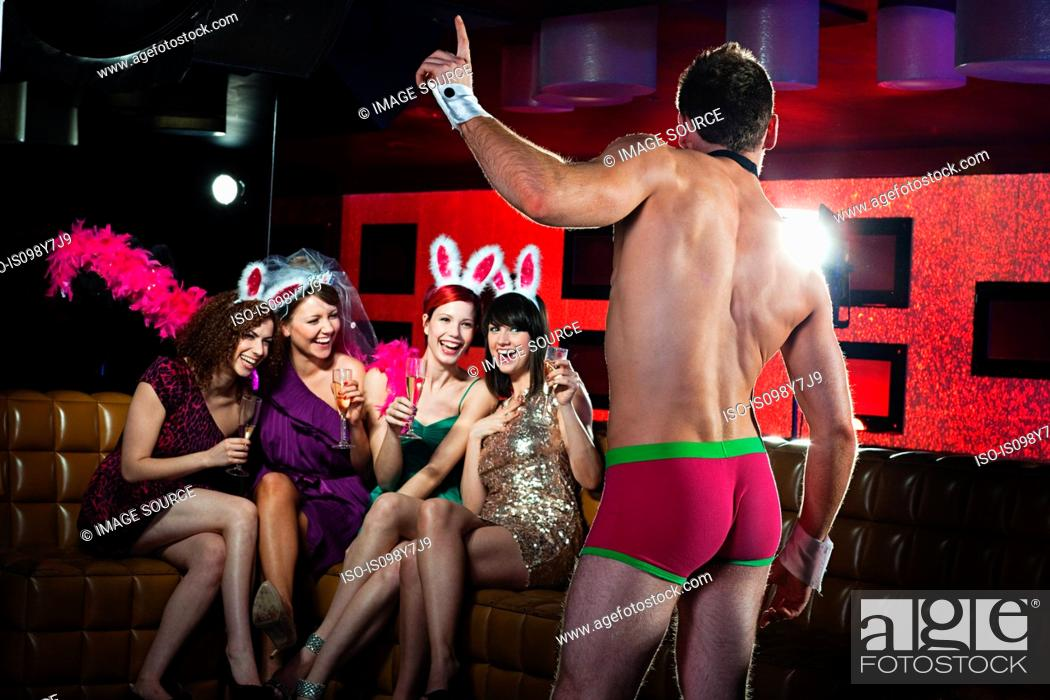 Stock Photo: Young women on hen night with male stripper.