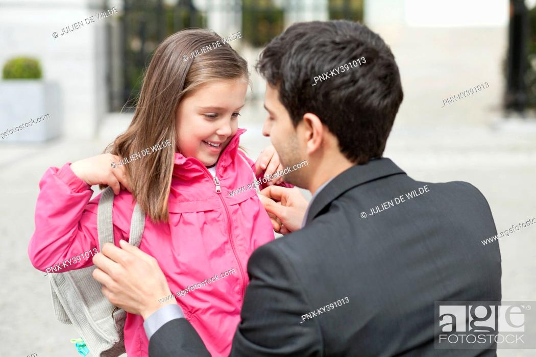 Stock Photo: Close-up of a girl with her father.