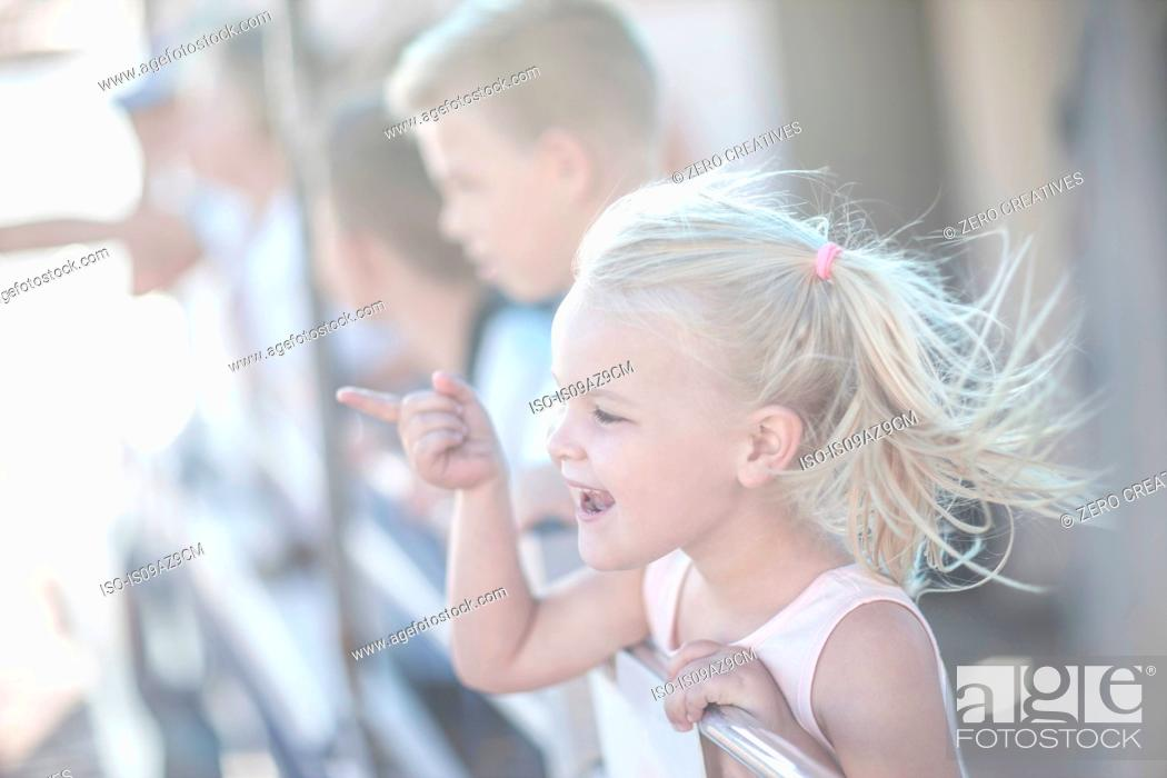 Stock Photo: Cute girl tourist pointing on boat trip, Cape Town, South Africa.