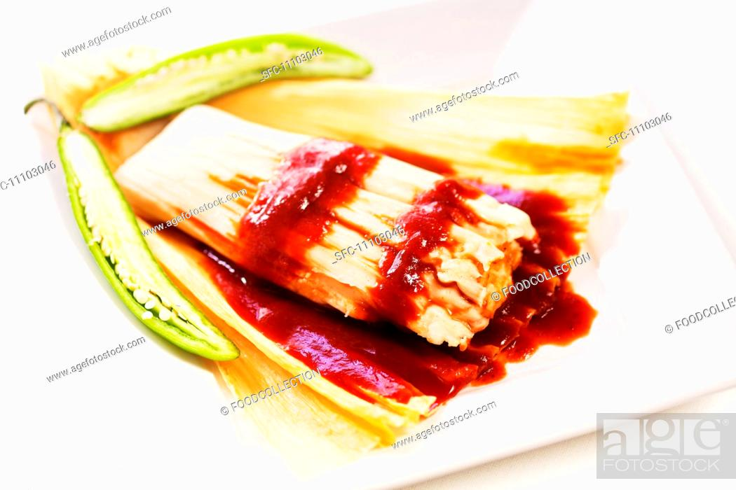 Stock Photo: Spicy Tamale with Husk Peeled Open.