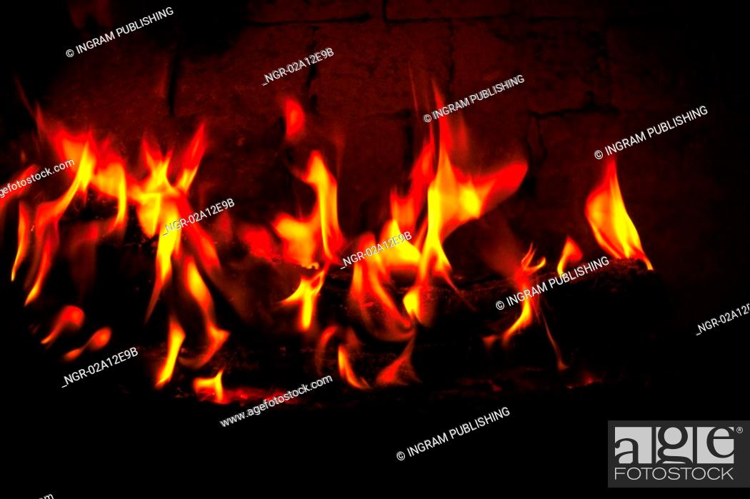 Stock Photo: Close-up of a fire lit in a fireplace.